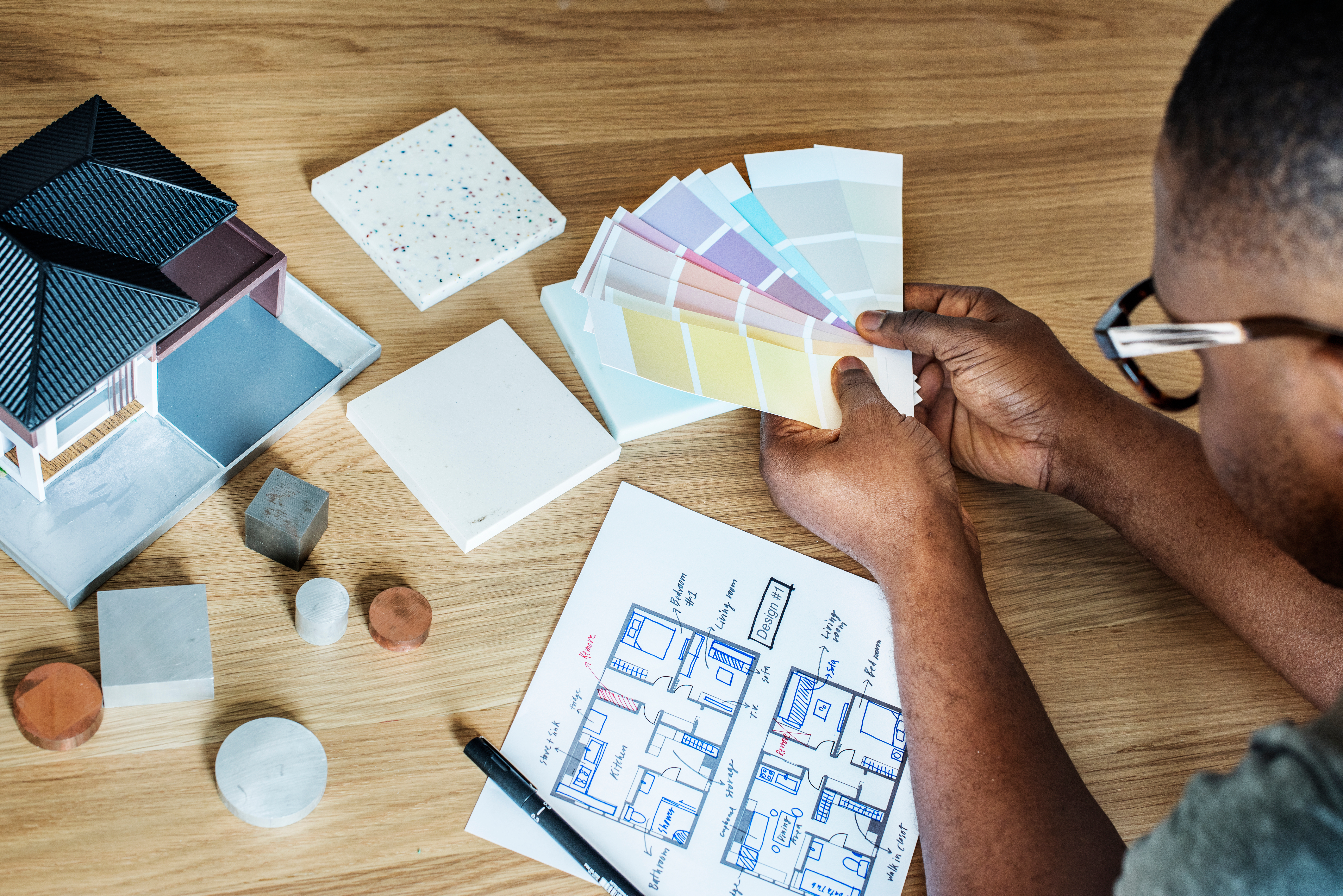 Man looking at paint color swatches