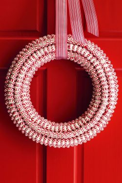 Peppermint wreath on a red door